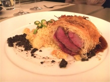Lamb fillet, Kataifi, Black Olives & Spiced Cous Cous